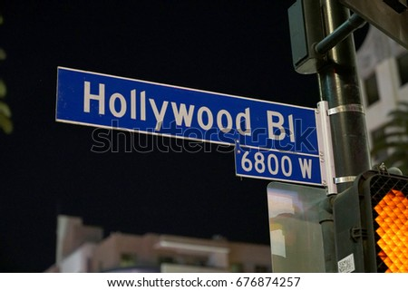 Los Angeles, California, USA - JUNE 24, 2017: Hollywood blvd street sign at night on Hollywood Boulevard