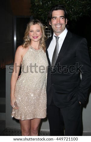 Los Angeles, California, USA; March 3, 2013; Amy Smart and Carter Ooosterhouse arrive to the 2nd Annual Evening of Environmental Excellence in Los Angeles, California.