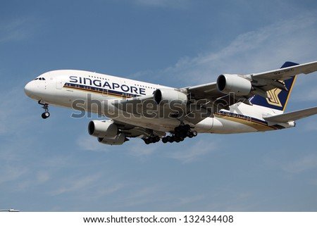 LOS ANGELES, CALIFORNIA, USA - MARCH 21, 2013 - Singapore Airlines Airbus A380-841 lands at Los Angeles Airport on March 21, 2013. It is the world's largest passenger airliner and seats 525 people. - stock photo