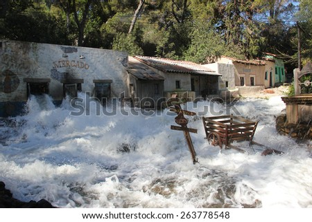 Los Angeles, California, USA - March 12, 2015: The downhill flood effect, appeared in Big Fat Liar and Fletch Lives movies, is shown during studio tour at Universal Studios Hollywood. - stock photo