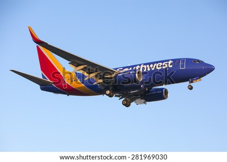 LOS ANGELES, CALIFORNIA/USA - MAY 24, 2015. Southwest Airlines Boeing 737-7H4 lands at Los Angeles Airport (LAX) on May 24, 2015. The plane has a range of 6,340 miles with 177 seats. - stock photo