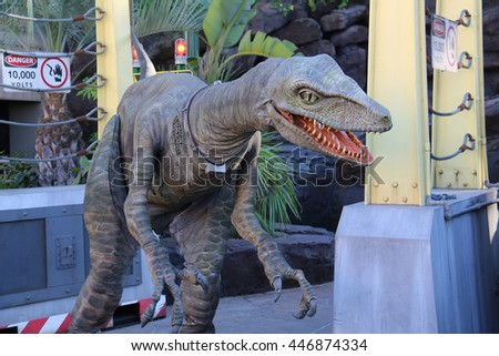 Los Angeles, California, USA - November 22, 2015: Raptor Encounter is an attraction visitors can meet a Velociraptor in front of Jurassic Park: The Ride at Universal Studios Hollywood. - stock photo