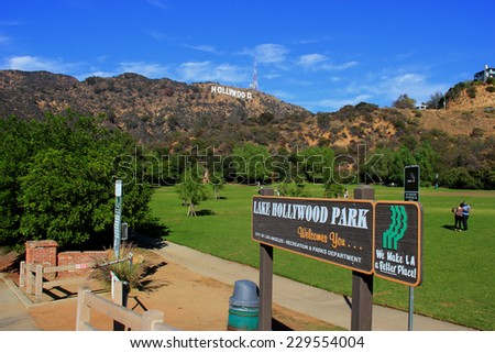 Los Angeles, California, USA - November 10, 2014: The Hollywood Sign, viewed from Lake Hollywood Park, is a landmark located on Mount Lee in the Hollywood Hills in Los Angeles, California.  - stock photo