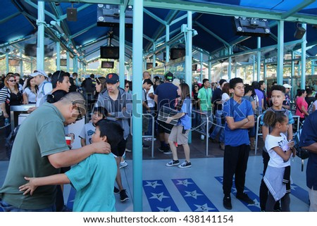 Los Angeles, California, USA - November 22, 2015: Tourists are waiting in line for Studio Tour Tram that takes them to visit the studios used in many Hollywood movies at Universal Studios Hollywood. - stock photo