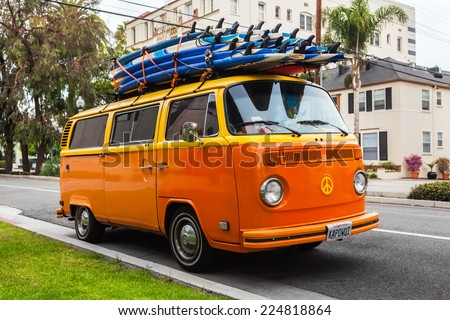 LOS ANGELES, CALIFORNIA, USA - OCT 21: Volkswagen transporter with surf boards parked on the street, Los Angeles, CA, USA on oct 21, 2013. Famous van was manufactured for about 64 years in 1949-2013. - stock photo