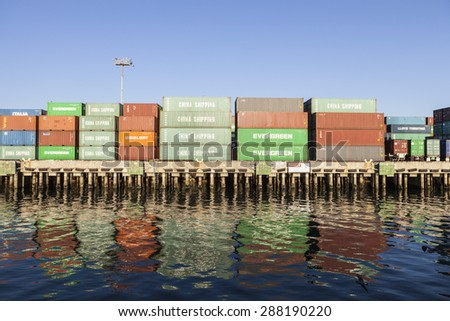 Los Angeles, California, USA - September 25, 2010:  Stacked dockside shipping containers in the congested Los Angeles harbor. - stock photo