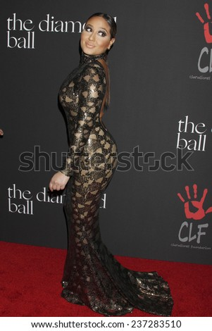 LOS ANGELES - DEC 11:  Adrienne Bailon at the Rihanna's First Annual Diamond Ball at the The Vineyard on December 11, 2014 in Beverly Hills, CA - stock photo
