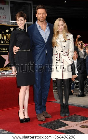 LOS ANGELES - DEC 13 - Anne Hathaway, Hugh Jackman and Amanda Seyfried arrives at the Hugh Jackman Star On The Hollywood Walk Of Fame Ceremony on December 13, 2012 in Los Angeles, CA              - stock photo