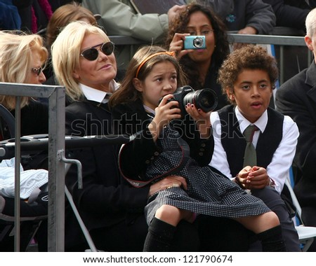 LOS ANGELES - DEC 13:  Deborra-Lee Furness with Ava and Oscar Jackman at the Hollywood Walk of Fame ceremony for Hugh Jackman at Hollywood Boulevard on December 13, 2012 in Los Angeles, CA - stock photo