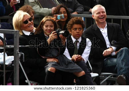 LOS ANGELES - DEC 13:  Deborra-Lee Furness with Ava and Oscar Jackman at the Hollywood Walk of Fame ceremony for Hugh Jackman on December 13, 2012 in Los Angeles, CA - stock photo