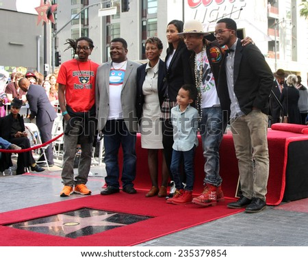 LOS ANGELES - DEC 4:  Helen Lasichanh, Rocket Williams, Pharrell Williams, Family at the Pharrell Williams Walk of Fame Star Ceremony at the W Hotel Hollywood on December 4, 2014 in Los Angeles, CA - stock photo