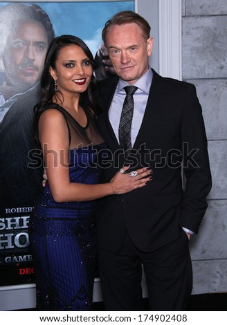 "LOS ANGELES - DEC 06:  JARED HARRIS & ALLEGRA RIGGIO arrives to the ""Sherlock Holmes A Game of Shadows"" Los Angeles Premiere  on December 06, 2011 in Westwood, CA                 - stock photo"