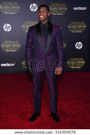 "LOS ANGELES - DEC 14:  John Boyega arrives to the ""Star Wars: The Force Awakens"" World Premiere  on December 14, 2015 in Hollywood, CA.                 - stock photo"