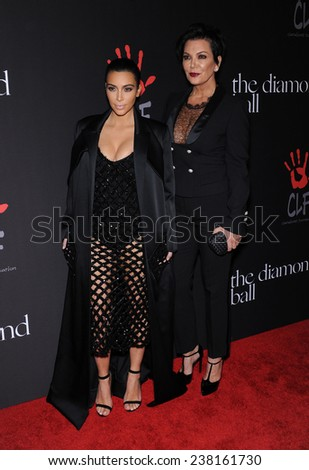 LOS ANGELES - DEC 11:  Kim Kardashian & Kris Jenner arrives to the The First Annual Diamond Ball on December 11, 2014 in Beverly Hills, CA                 - stock photo