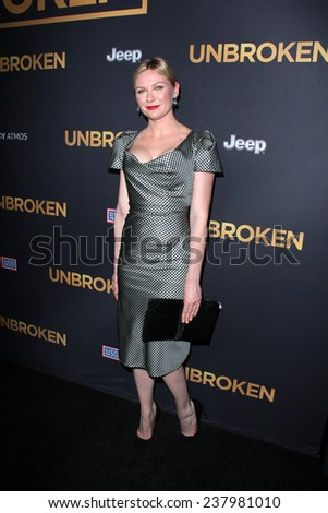 """LOS ANGELES - DEC 15:  Kirsten Dunst at the """"Unbroken"""" - Los Angeles Premiere at the Dolby Theater on December 15, 2014 in Los Angeles, CA - stock photo"""