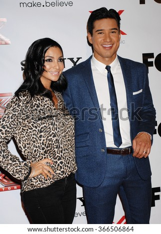 LOS ANGELES - DEC 6 - Mario Lopez and wife Courtney Mazza arrives at the X Factor Viewing Party  on December 6, 2012 in Los Angeles, CA              - stock photo