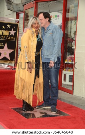 LOS ANGELES - DEC 21:  Pam Grier, Quentin Tarantino at the Quentin Tarantino Hollywood Walk of Fame Star Ceremony at the Hollywood Blvd on December 21, 2015 in Los Angeles, CA - stock photo