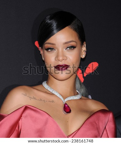 LOS ANGELES - DEC 11:  Rihanna arrives to the The First Annual Diamond Ball on December 11, 2014 in Beverly Hills, CA                 - stock photo