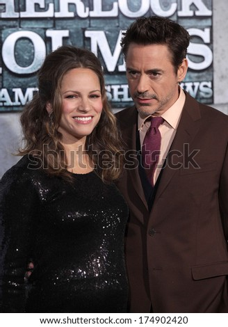 "LOS ANGELES - DEC 06:  ROBERT DOWNEY JR. & SUSAN arrives to the ""Sherlock Holmes A Game of Shadows"" Los Angeles Premiere  on December 06, 2011 in Westwood, CA                 - stock photo"