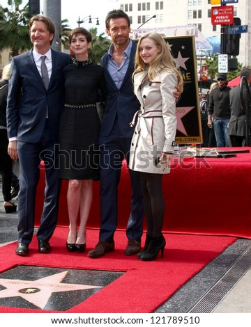 LOS ANGELES - DEC 13:  Tom Hooper, Anne Hathaway, Hugh Jackman, Amanda Seyfried at the Hollywood Walk of Fame ceremony for Hugh Jackman at Hollywood Boulevard on December 13, 2012 in Los Angeles, CA - stock photo