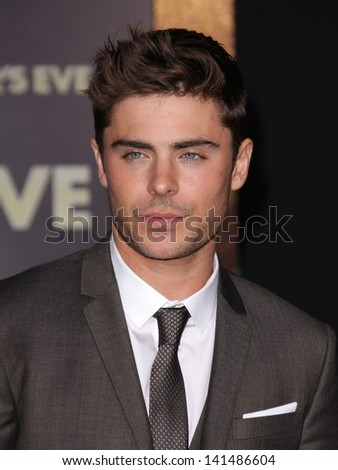 "LOS ANGELES - DEC 05:  ZAC EFRON arriving to ""New Year's Eve"" World Premiere  on December 5, 2011 in Hollywood, CA - stock photo"