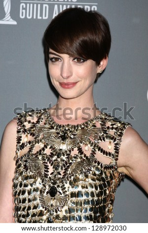 LOS ANGELES - FEB 19:  Anne Hathaway arrives at the 15th Annual Costume Designers Guild Awards at the Beverly HIlton Hotel on February 19, 2013 in Beverly Hills, CA - stock photo
