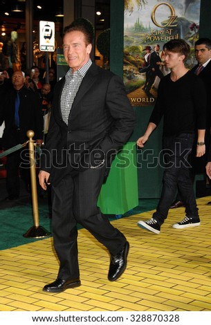 LOS ANGELES - FEB 13 - Arnold Schwarzenegger arrives at the Oz The Great and Powerful World Premiere on February 13, 2013 in Los Angeles, CA              - stock photo