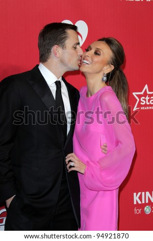 LOS ANGELES - FEB 10:  Bill Rancic; Giuliana Rancic arrives at the 2012 MusiCares Gala honoring Paul McCartney at LA Convention Center on February 10, 2012 in Los Angeles, CA - stock photo
