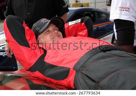 LOS ANGELES - FEB 7:  Brett Davern at the Toyota Grand Prix of Long Beach Pro/Celebrity Race Press Day at the Grand Prix Compound on FEB 7, 2015 in Long Beach, CA - stock photo