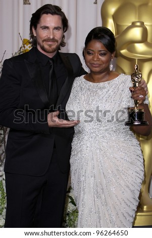 LOS ANGELES - FEB 26:  Christian Bale; Octavia Spencer arrives at the 84th Academy Awards at the Hollywood & Highland Center on February 26, 2012 in Los Angeles, CA. - stock photo