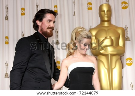LOS ANGELES -  FEB 27:  Christian Bale, Reese Witherspoon arrive in the Press Room at the 83rd Academy Awards at Kodak Theater, Hollywood & Highland on February 27, 2011 in Los Angeles, CA - stock photo