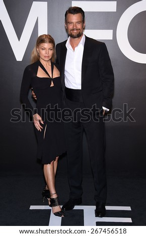 LOS ANGELES - FEB 20:  Fergie & Josh Duhamel arrives to the Tom Ford Autumn/Winter 2015 Womenswear Collection Presentation  on February 20, 2015 in Hollywood, CA                 - stock photo