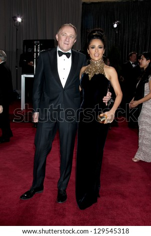 LOS ANGELES - FEB 24:  Francois-Henri Pinault, Salma Hayek arrive at the 85th Academy Awards presenting the Oscars at the Dolby Theater on February 24, 2013 in Los Angeles, CA - stock photo