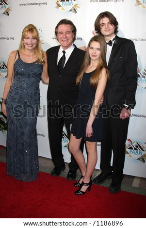 LOS ANGELES - FEB 10:  Frank Dicopoulos, wife Teja, son Jaden, daughter Olivia arrives at the 2011 FAAN Los Angeles Gala  at El Rey Theater on February 10, 2011 in Los Angeles, CA