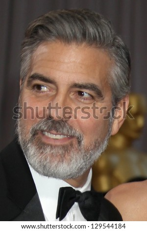 LOS ANGELES - FEB 24:  George Clooney arrives at the 85th Academy Awards presenting the Oscars at the Dolby Theater on February 24, 2013 in Los Angeles, CA - stock photo