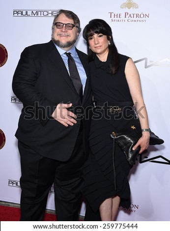 LOS ANGELES - FEB 14:  Guillermo de Toro & Lorenza Newton arrives to the Make-Up Artists & Hair Stylists Guild Awards 2015  on February 14, 2015 in Hollywood, CA                 - stock photo