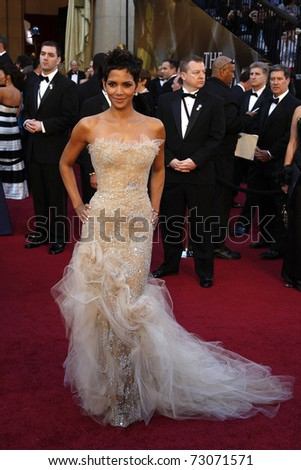 LOS ANGELES - FEB 27:  Halle Berry arrives at the 83rd Annual Academy Awards - Oscars at the Kodak Theater on February 27, 2011 in Los Angeles, CA. - stock photo