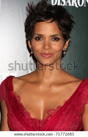 LOS ANGELES - FEB 22:  Halle Berry arrives at the 13th Annual Costume Designers Guild Awards at Beverly Hilton Hotel on February 22, 2011 in Beverly Hills, CA - stock photo