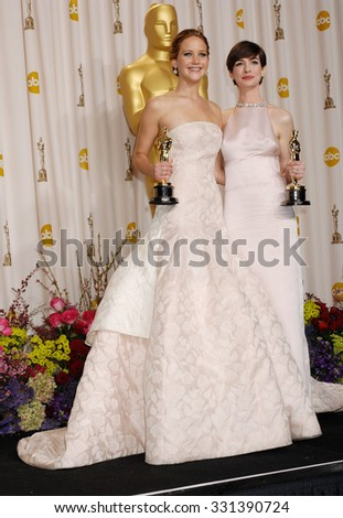 LOS ANGELES - FEB 24 - Jennifer Lawrence and Anne Hathaway arrives at the 85th Annual Academy Awards Press Room  on February 24, 2013 in Los Angeles, CA              - stock photo
