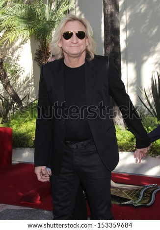 LOS ANGELES - FEB 09:  Joe Walsh arrives to the Walk of Fame Ceremony for Paul McCartney  on Febraury 09, 2012 in Hollywood, CA                 - stock photo