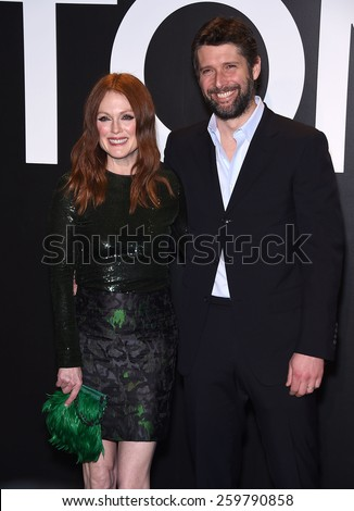 LOS ANGELES - FEB 20:  Julianne Moore & Bart Freundlich arrives to the Tom Ford Autumn/Winter 2015 Womenswear Collection Presentation  on February 20, 2015 in Hollywood, CA                 - stock photo