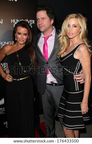 "LOS ANGELES - FEB 11:  Kyle Richards, Jamie Kennedy, Camille Grammer at the ""The Hungover Games"" Premiere at TCL Chinese 6 Theater on February 11, 2014 in Los Angeles, CA"