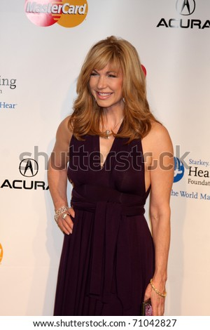 LOS ANGELES - FEB 11:  Leeza Gibbons arrives at the Muiscares Gala Honoring Barbra Streisand at Convention Center on February 11, 2011 in Los Angeles, CA