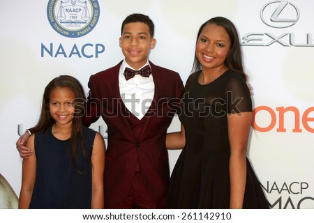 LOS ANGELES - FEB 6:  Marcus Scribner, sisters at the 46th NAACP Image Awards Arrivals at a Pasadena Convention Center on February 6, 2015 in Pasadena, CA - stock photo