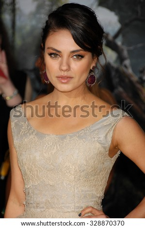 LOS ANGELES - FEB 13 - Mila Kunis arrives at the Oz The Great and Powerful World Premiere on February 13, 2013 in Los Angeles, CA              - stock photo
