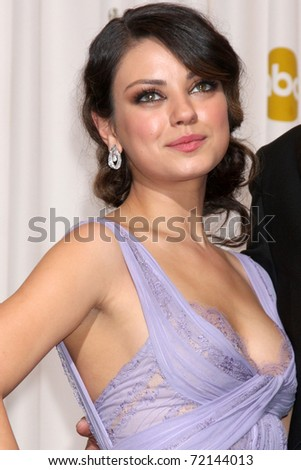 LOS ANGELES -  FEB 27: Mila Kunis arrives in the Press Room at the 83rd Academy Awards at Kodak Theater, Hollywood & Highland on February 27, 2011 in Los Angeles, CA - stock photo