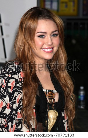 "LOS ANGELES - FEB 8:  Miley Cyrus arrives at the ""Never Say Never"" Premiere at Nokia Theater  on February 8, 2011 in Los Angeles, CA - stock photo"