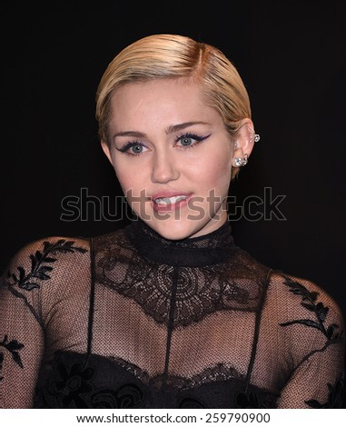 LOS ANGELES - FEB 20:  Miley Cyrus arrives to the Tom Ford Autumn/Winter 2015 Womenswear Collection Presentation  on February 20, 2015 in Hollywood, CA                 - stock photo