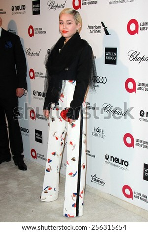 LOS ANGELES - FEB 22: miley cyrus at the Elton John Oscar Party 2015 at the City Of West Hollywood Park on February 22, 2015 in West Hollywood, CA - stock photo