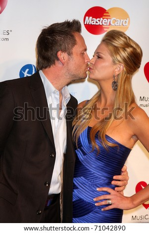 LOS ANGELES - FEB 11:  Nancy O'Dell & Husband arrives at the Muiscares Gala Honoring Barbra Streisand at Convention Center on February 11, 2011 in Los Angeles, CA - stock photo
